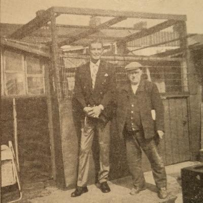Photo of Bob Funk and Wilf Lovatt standing in front of Wilf's Loft